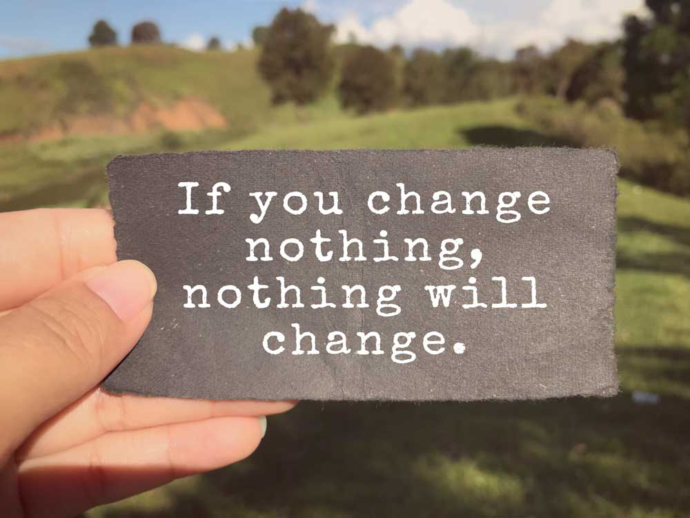 Sign saying: If you change nothing, nothing will change.