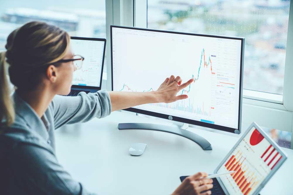 Woman doing data-driven assessment on computer